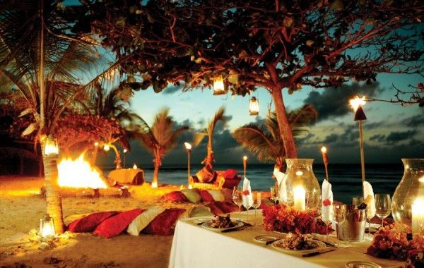 Picturesque romantic place inspired candlelight sunset sea sand flowers mussels idea