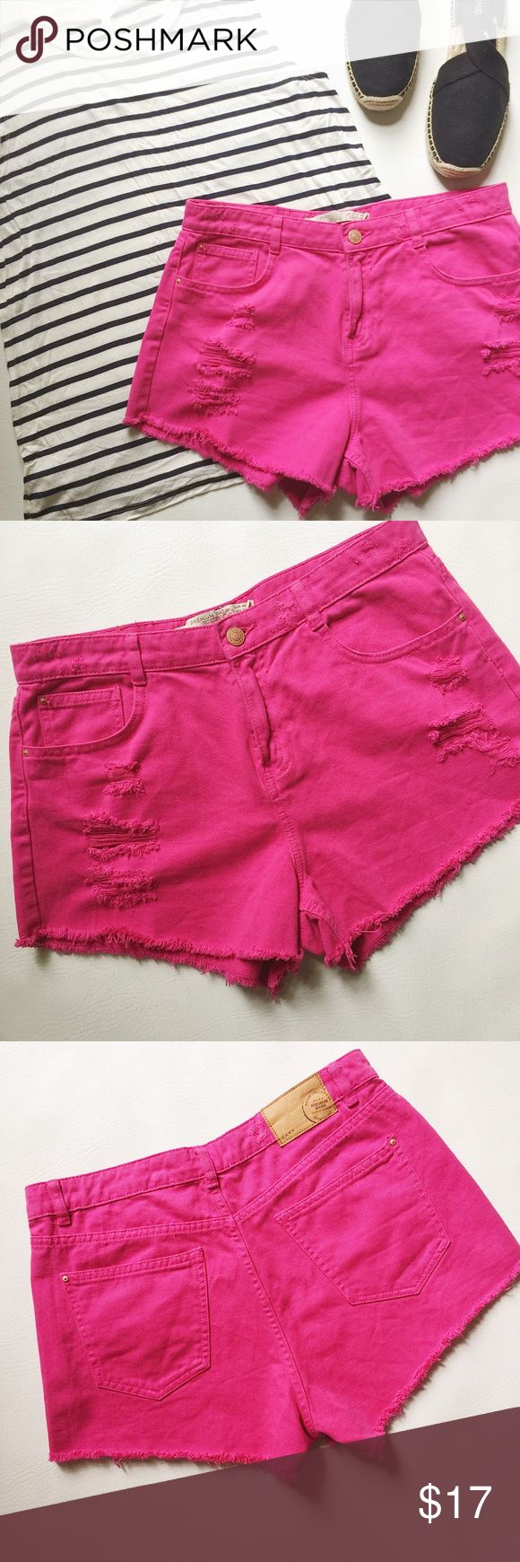 "Zara Ripped Denim Shorts Zara Ripped Denim Shorts in pink featuring factory distressing. Bright, cheerful color! Pre-loved but in excellent condition. No holes, stains or damage. Last 2 pics stock photos, used to show fit and true color. Measurements laying flat: Waist (across): 15.5"" Hips: 19.5"" Inseam: 2"" Rise: 10.5"" Zara Shorts"
