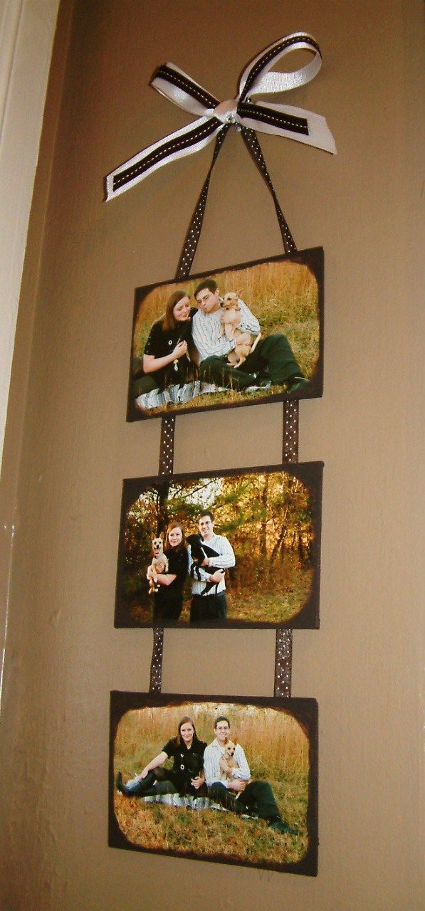 Pictures put on canvas hung with ribbon :)