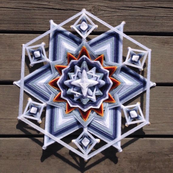 This unique mandala was woven when I was snowed in for three days in the winter of 2015. At its heart is the warm fire of love and family, the safety of which allows one to appreciate the beauty and intricacy of nature. It is woven on oak dowels with acrylic and wool yarns. It will be shipped in a custom box and can be delivered safely anywhere in the world.