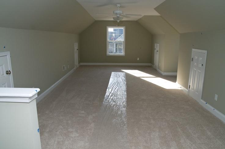Bonus room with front window, dormer window, & attic storage access. | Dream