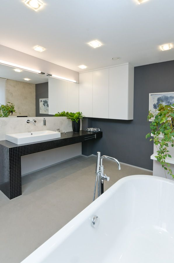 OOOOX   NAD VODOVODEM - bathroom with black mosaic desk and grey cement walls