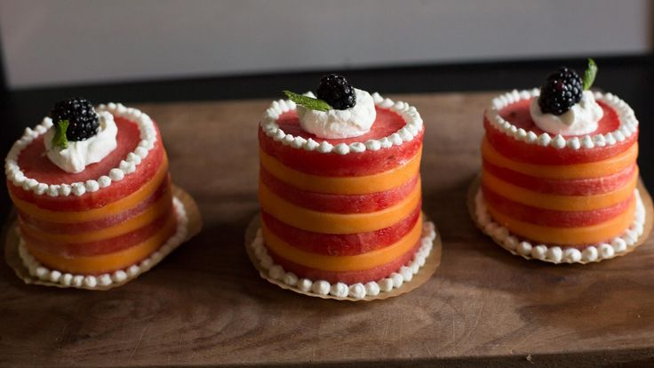 Looking for a quick and healthy dessert? Try making these mini melon cakes! They are the perfect party treat for a hot summer day, but really can be served all year round. These fresh fruit cakes use cantaloupe, watermelon, whipped cream, and a blackberry, and mint leaf as garnish.