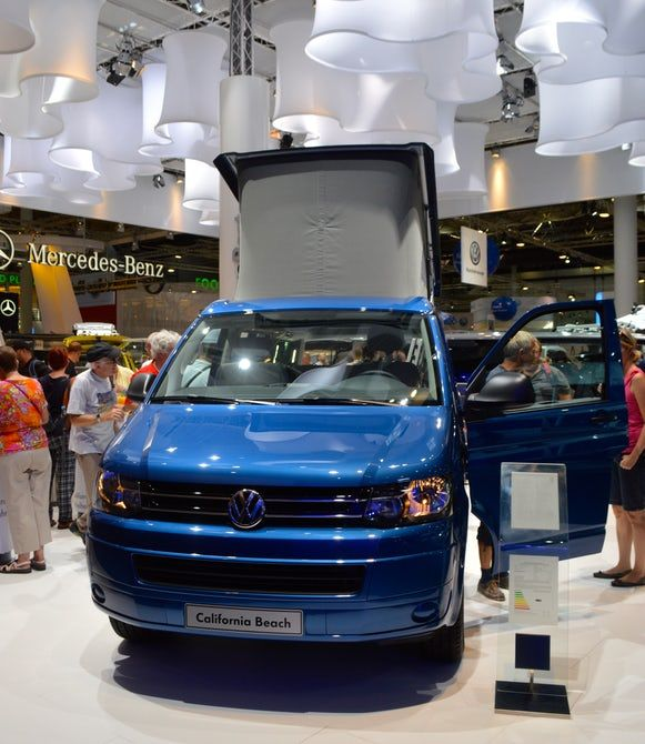 the vw california beach painted in olympia blue metallic has a manual pop up roof volkswagen bus camper volkswagen camper volkswagen bus pinterest