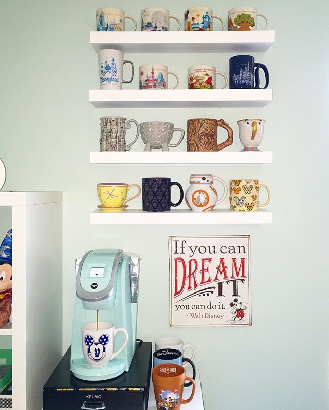 I'm in the process of turning a room in my house into an office and this is my new favorite spot! ☕️✨ #disneymugs #waltdisneyworld #disneyland •If you follow me on @bibbidibobbidibrooke you already saw this today sorry! I just had to share again! •mugs: my many Disney trips; shelves: Amazon; keurig: target; sign: hobby lobby
