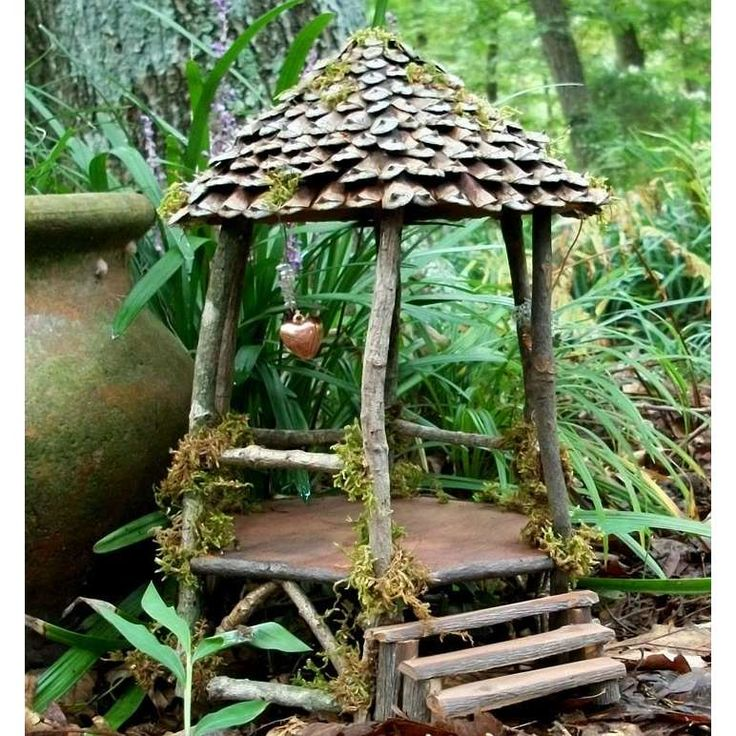 Gazebo for the fairy folk - love the pine cone roof tiles