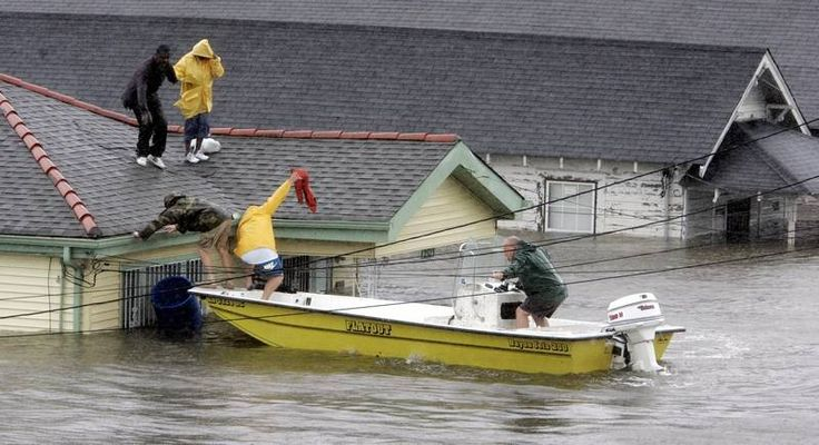 Bryan Vernon and Dorothy Bell are rescued from their  rooftop after  Hurricane Katrina hit, causing flooding in their New Orleans neighborhood,  Monday Morning, Aug. 29,  2005. Officials called for a mandatory evacuation of the city, but many residents remained in the city.
