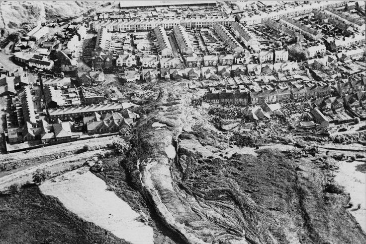 The Aberfan disaster was a catastrophic collapse of a colliery spoil tip in the Welsh village of Aberfan, on Friday 21 October 1966, killing 116 children and 28 adults. It was caused by a build-up of water in the accumulated rock and shale, which suddenly started to slide downhill in the form of slurry.  Over 40,000 cubic metres of debris landed on the village in minutes, and the Junior School were immediately inundated, with young children and teachers dying from impact or suffocation.