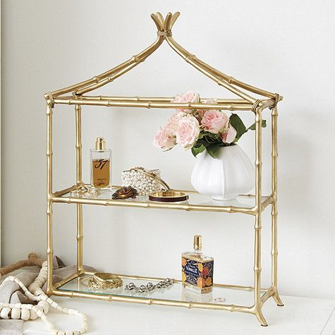 The pagoda frame and airy glass shelves create a graceful display for pretty perfume bottles and cosmetics in the bath or dressing area. Frame is hand crafted of aluminum with delicate bamboo details. Mei Pagoda Shelf features: Tempered glass shelvesSplayed feet for stability
