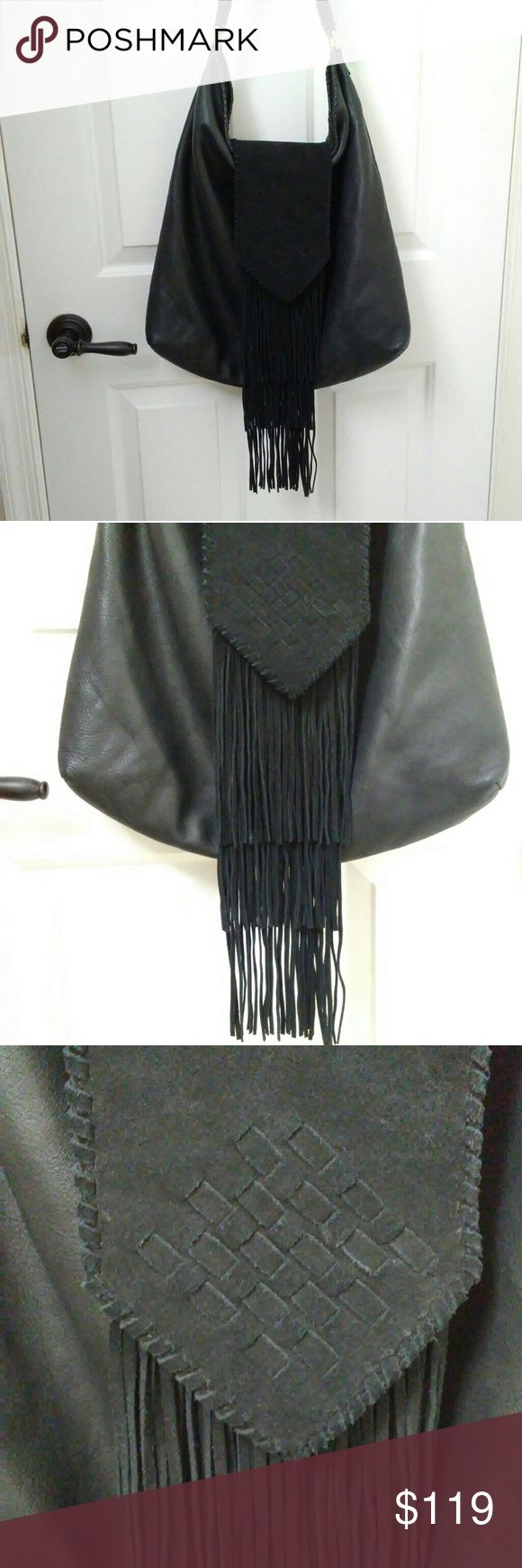 MARGOT Leather Purse Suede Fringe Festival Bag XL MARGOT Black Leather and Suede Fringe Hobo Festival Bag  Absolutely gorgeous black leather and suede bag by Margo. Western touches at the hem and strap combine effortlessly with the a hippie / festival vibe of the fringe and versatility Butter soft with a pebbled texture and crossover weave design on the suede flat. No top closure - the fringed suede flap keeps the bag closed. 2 small interior pouch pockets and 1 zipper pocket inside.…