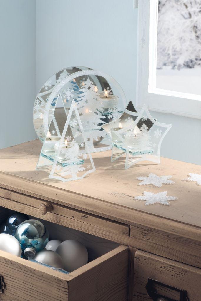 Specchi decorati per questi portacandele, che riflettono la luce della fiamma creando un'atmosfera magica e suggestiva