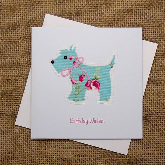 This is a beautiful smooth white square card embellished with a floral fabric printed Scottie dog with a glossy black bead nose and eye, finished with Birthday Wishes printed in pink. The wording inside of the card is Have a special day written in black ink. Card: High quality