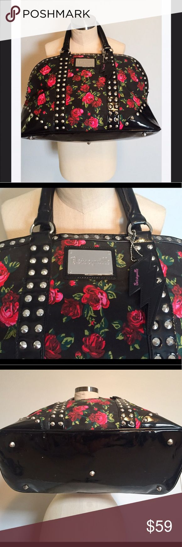 "Betseyville XL Studded Floral Tote Bag Amazing bag that is perfect for weekend getaways or just daily commuting! Lots of space to carry everything. Colors of black, red, and green with gorgeous silver studs throughout. Full zipper over the top. 22x14x8"". Still in very good condition from minimal use. From a smoke and pet free home. Bundle it with over 200 items for an additional 20% off or more! Betsey Johnson Bags Totes"