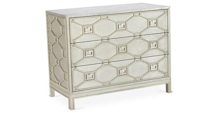 Crafted of MDF and zinc, this chest's design offers an incredible texture and depth. Three large drawers offer a wealth of storage space.