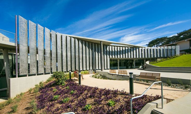 The Science Center at the Point Loma Nazarene University campus features a long arc of perforated stainless-steel screens.
