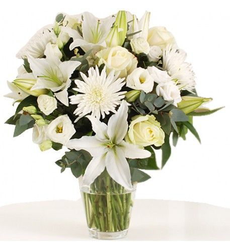 This arrangement contains the following flowers: 3 x White Oriental Lilies 3 x White Bloom Chrysanthemums 4 x White Avalanche Roses 3 x White Lisianthus 1 x Eucalyptus and Salal Foliage Hand-tied by our florists -Please note the vase is not included.