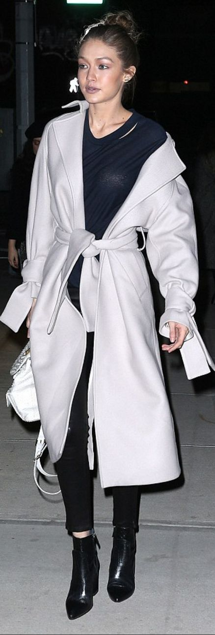 Who made  Gigi Hadid's tan coat, ankle boots, ripped top, patent pants, and white backpack?