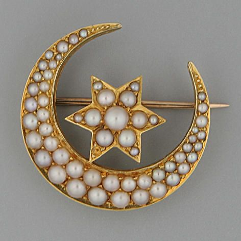 A Victorian seed pearl crescent brooch Of enclosed star design, 3.0cm overall.