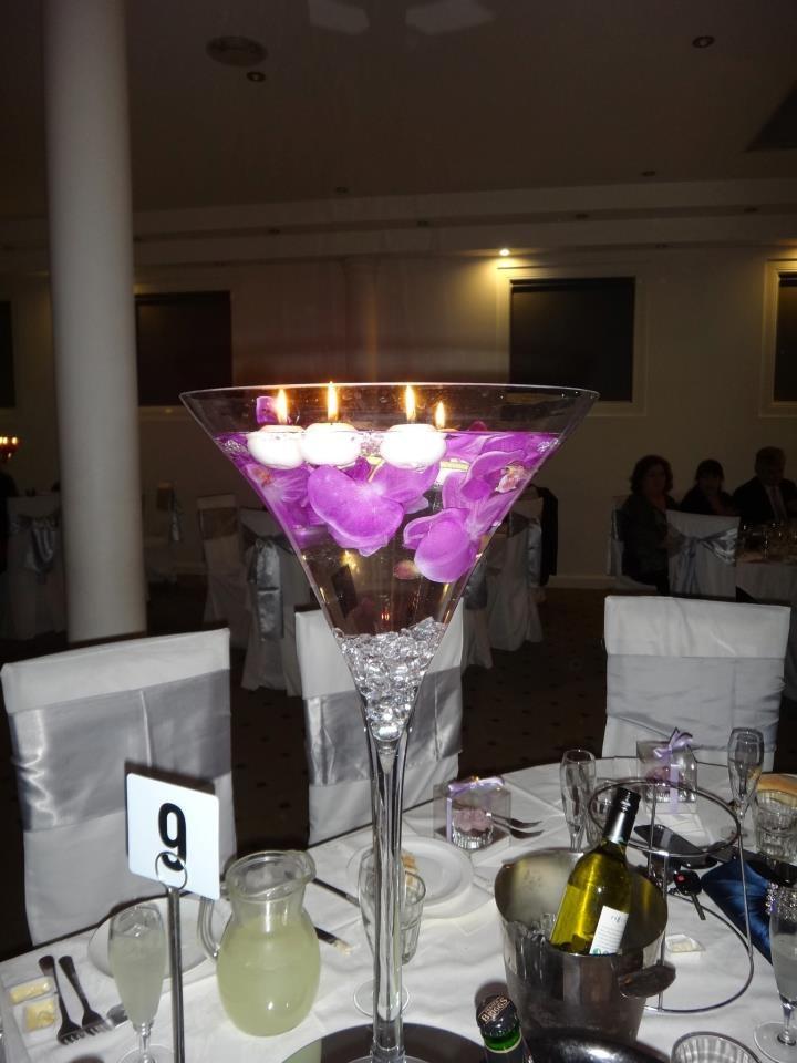 Silk subnersed orchids in martini vase