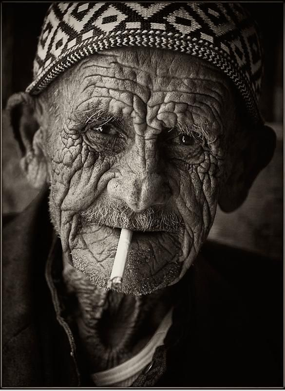Israel, man, male, guy, oldie, aged, cigarette, smoking, wrinckled, aged, charming, face, intense, a face that have stories to tell, have lived a lifetime, portrait, photograph, photo b/w.                                                                                                                                                                                 More