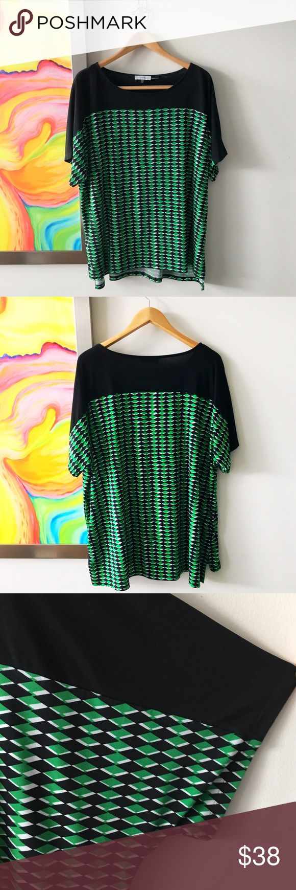 CALVIN KLEIN Geo Green Tunic Worn once. Pretty geometric pattern in kelly green, black and white. Sleeves hit above interior elbow and higher on the outside, like a soft batwing style. Great with skinny jeans or belted with a skirt. True to size. Calvin Klein Tops Tunics