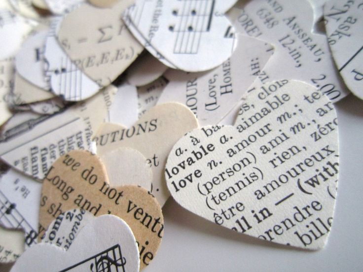 Heart confetti from books. Definitely would look great on the tables.