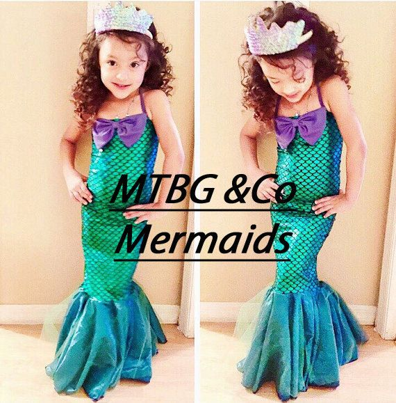 toddlers and girls mermaid full dress with halter and purple bow, mermaid dress costume, mermaid party costume, mermaid outfit. Full mermaid dress, tail flare at the bottom, Custom made to: Chest Waist Hips Chest to knee cap Knee cap to floor Available for babies, toddlers, and girls. Custom made/ made to order Head bow and crown not available.. DRESS ONLY  Thank you. Please check store policies
