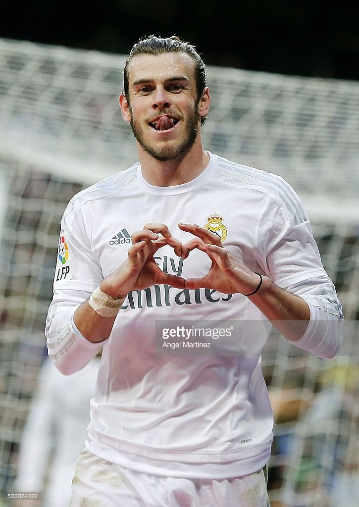 <a gi-track='captionPersonalityLinkClicked' href=/galleries/search?phrase=Gareth+Bale&family=editorial&specificpeople=609290 ng-click='$event.stopPropagation()'>Gareth Bale</a> of Real Madrid celebrates after scoring his team's eighth goal during the La Liga match between Real Madrid CF and Rayo Vallecano at Estadio Santiago Bernabeu on December 20, 2015 in Madrid, Spain.