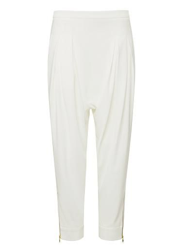 SEED Collection Polyester/Elastane Skinny Harem pant. Comfortable fitting silhouette features a fixed waistband with invisible side zipper, front body tucks and drop crotch with tapered leg complete with exposed gold zippers at hem. Available in various colours as shown.