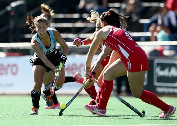 Lucina von der Heyde of Argentina attempts to break through the Chile defence during day 2 of the FIH Hockey World League Semi Finals Pool B match between Argentina and Chile at Wits University on July 10, 2017 in Johannesburg, South Africa.