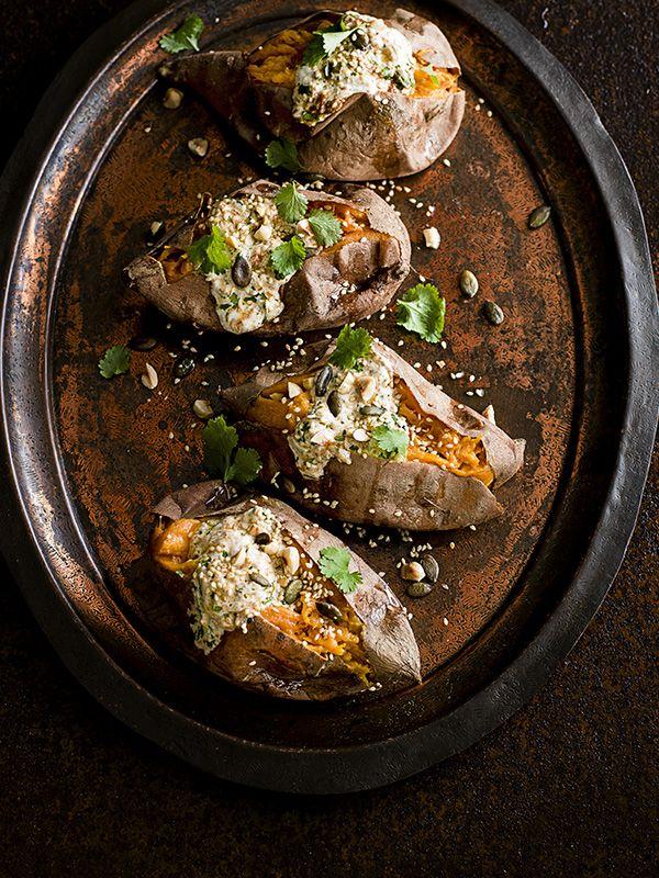 Roasted sweet potatoes with harissa yogurt, toasted nuts and seeds