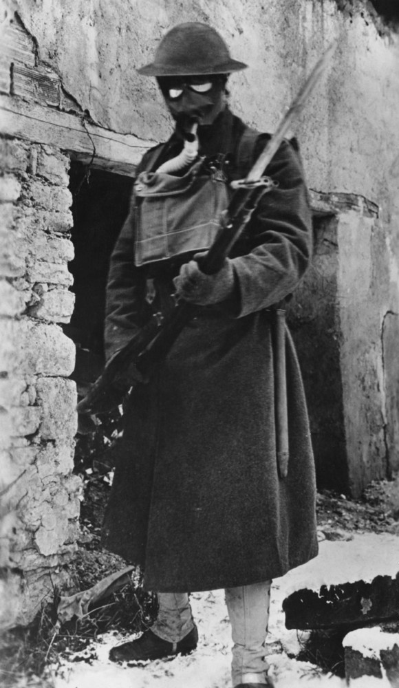 An American soldier dressed for a gas attack during World War I, circa 1916.