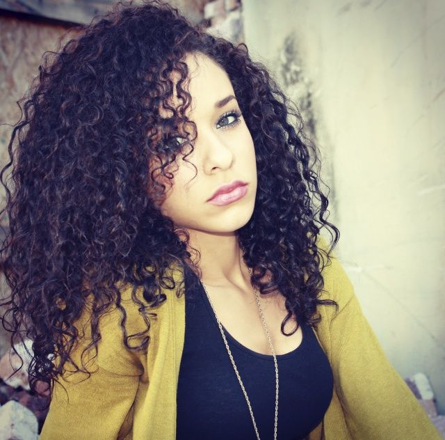 Light skinned girl with curly hair