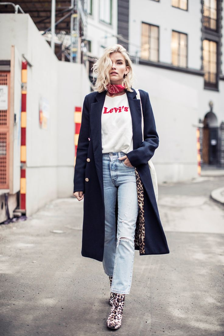 "Seen on the streets of Stockholm. Elsa Ekman wears a Levi's 501 Skinny in ""Clear Minds"" with our relaxed, graphic crew sweatshirt. Photo: Emma Svensson"