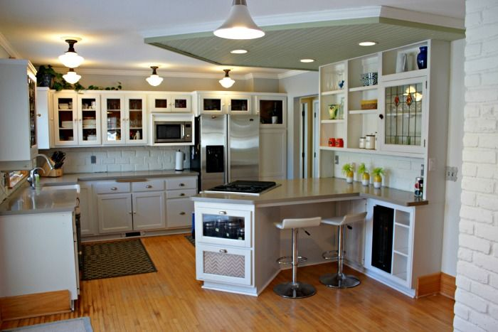 10 Creative Ideas to Add Personal Style to Your Kitchen.  An architectural detail of the hutch and drop ceiling in this kitchen make a big impact.