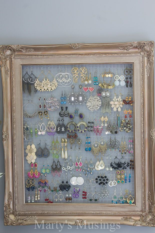 Blogger Marty's Musings shows you how to decorate a bedroom for practically nothing using yard sale finds, thrifted decor and DIY projects with creativity. This easy DIY frame for jewelry is easy and inexpensive with a $1 yard sale frame and some chicken