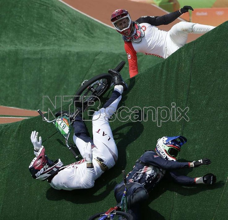 Liam Phillips of Great Britain (R), David Graf of Switzerland (L), and Maris Stormbergs of Latvia (C) crash during the men's BMX Cycling quarterfinal competition of the Rio 2016 Olympic Games at the Olympic BMX Centre in Rio de Janeiro, Brazil, 18 August 2016. EPA/FAZRY ISMAIL