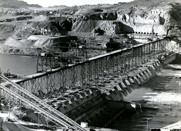 "Learn more: Completed in 1941, The GRAND COULEE DAM was the biggest hydroelectric power producing facility in the world. Woody was commissioned to write about the project put forth by the Works Progress Administration:   ""Well, the world has seven wonders that the trav'lers always tell, Some gardens and some towers, I guess you know them well, But now the greatest wonder is in Uncle Sam's fair lang,It's the big Columbia River and the big Grand Coulee Dam."""