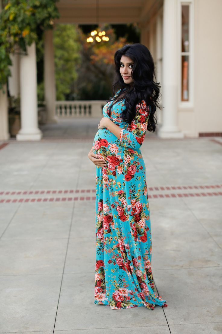 Who says maternity dresses have to be boring?  This Aqua Floral Wrap Dress from Pink Blush Maternity is sooo comfortable and stylish! It's perfect during the third trimester when you can proudly style your bump :) #PregnancyStyle