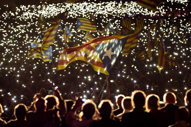 """Supporters of Catalan independence wave flags during a """"Together for YES"""" rally in Barcelona, Spain, Sept. 25. Catalans vote Sunday in regional parliamentary elections that the breakaway camp hopes will give them a mandate to put their region on a path toward independence - a goal the Madrid central government says would be illegal - nbcnews.com, September 25"""