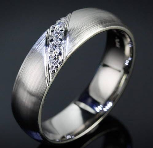 Masculine brushed white gold engagement ring with diagonal accent diamonds.