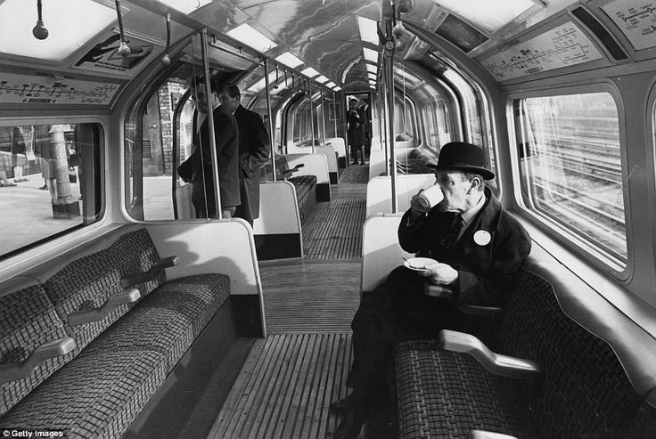 A London Underground official drinking a cup of coffee during trials of new automatic trains on a section of the Central Line