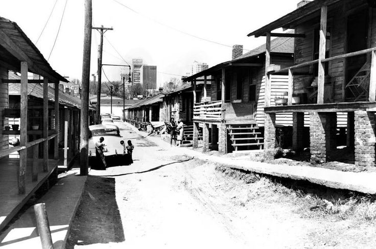This photo, taken in the old Brooklyn neighborhood, was typical of the image often presented of Charlotte's historically black neighborhood near uptown. In reality, the area was made up of mixed-income residences and businesses. Poverty did exist, but so did spacious brick homes, movie theaters, corner stores, churches and professional buildings.