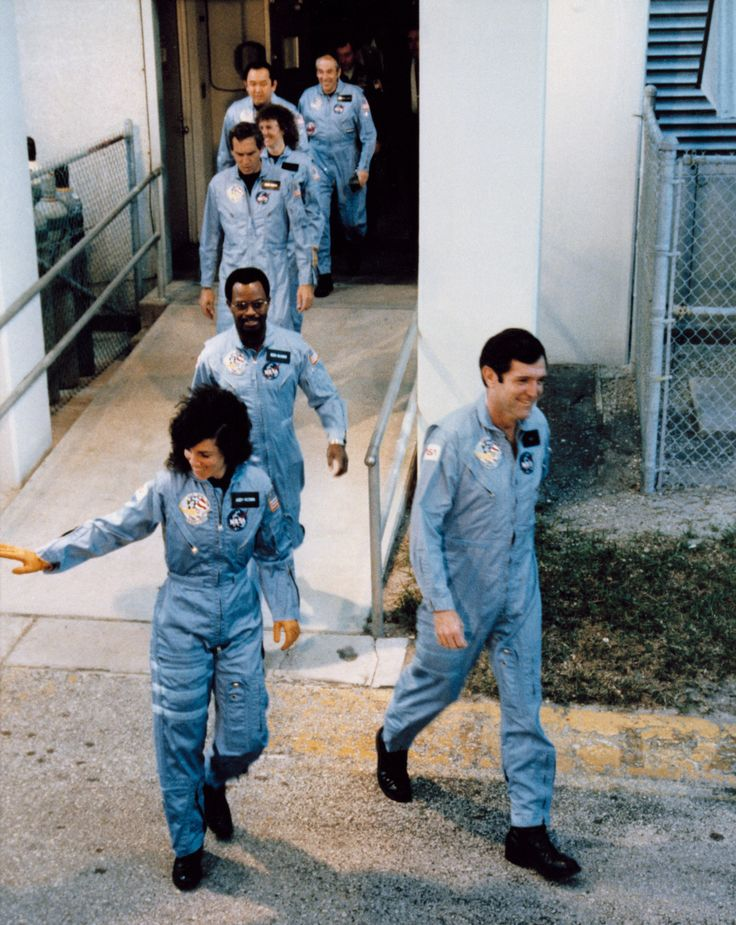 WAVING GOODBYE — The crew of mission STS-51L on the way to board the Space Shuttle Challenger on January 28, 1986. The flight would end in tragedy shortly after liftoff. Front to back: Commander Francis R. (Dick) Scobee; Mission Specialists Judith A. Resnik and Ronald E. McNair; Pilot Michael J. Smith; Payload specialist Christa McAuliffe; Mission Specialist Ellison Onizuka; and Payload specialist Gregory Jarvis. (NASA)