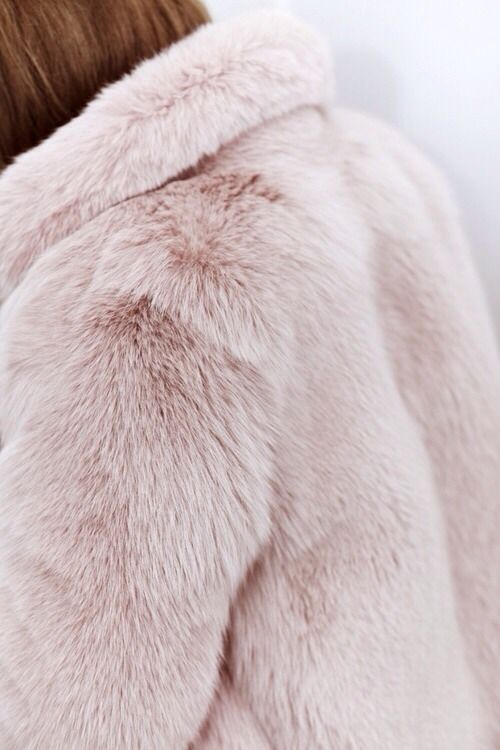 I hope that fur is faux. It's very beautiful though.