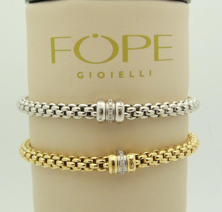 Beauty meets simplicity ladies in these Flex'IT 18K gold & Palladium bracelets made in Italy by designer Fope
