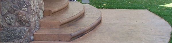 Rounded concrete steps.