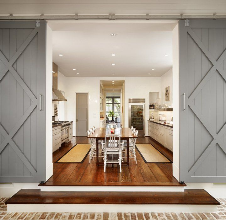 Dillon Kyle Architecture: Gray Sliding Barn Doors Leading To Large Kitchen  With Central Breakfast Table.