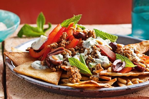 Twist on nachos, substituting Greek-style lamb and pita bread for the traditional mince and corn chips.