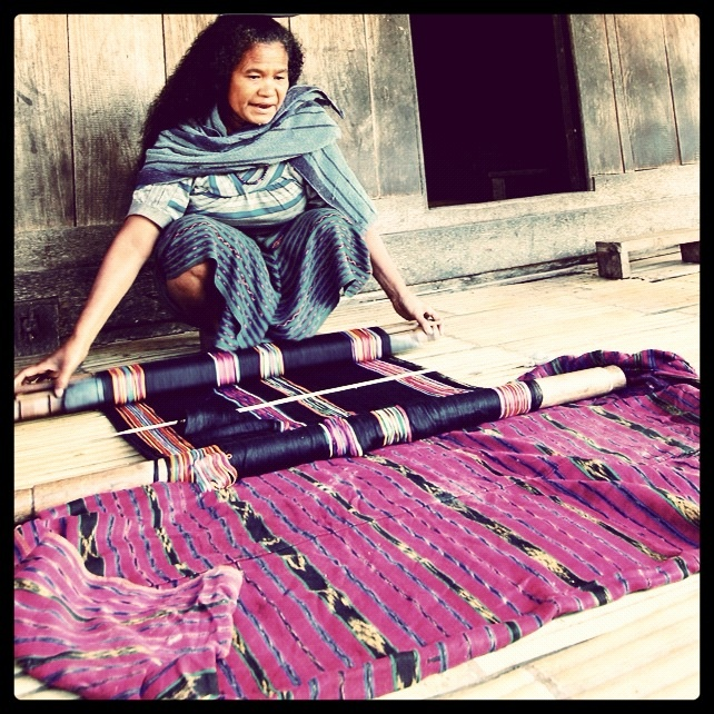 """A Lady showing her handmade """"tenun Ikat"""", Florest traditional  handicraft, Indonesia"""